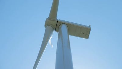 Wind Generator with Rotating Blades Against Clear Sky