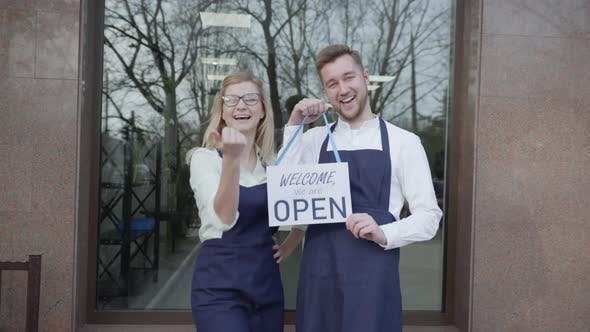 Thumbnail for Open Shop, Young Partners Rejoice at Opening of Small Business, Standing with Sign Open