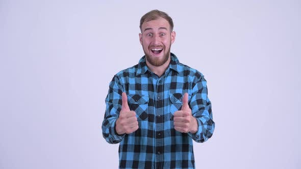 Thumbnail for Happy Bearded Hipster Man Giving Thumbs Up and Looking Excited