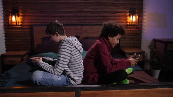 Cover Image for Mixed Race Teens Playing Video Games on Phones