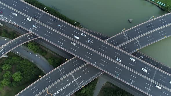 Thumbnail for Aerial Drone View of Highway Multi-level Junction Road with Moving Cars at Sunset. Cars Are Moving