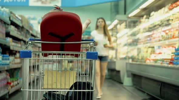 Thumbnail for Child Sits in a Specially Equipped Chair in the Supermarket