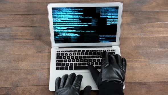 Digital animation of hackers hands on the laptop keyboard 4k