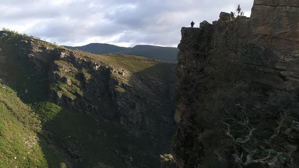 Thumbnail for Man on Top of Cliff