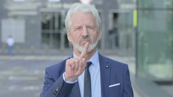 Outdoor Old Businessman Showing No Sign By Finger Sign