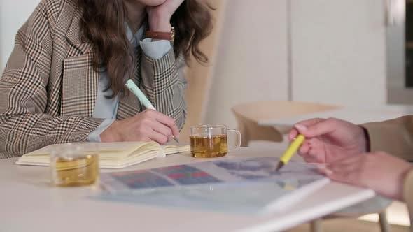 Two Businesswomen Analyzing Chart