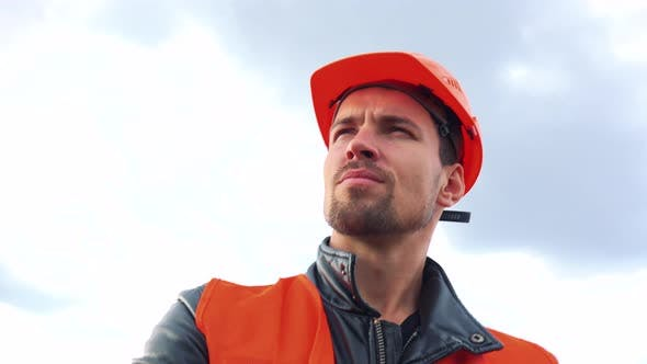 Thumbnail for A Young Construction Worker Looks Around