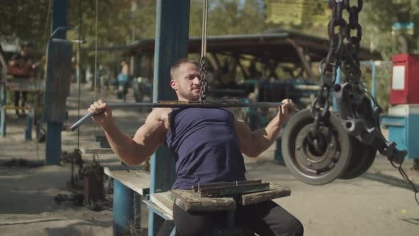 Thumbnail for Man Working Out on Cable Lat Pulldown Machine