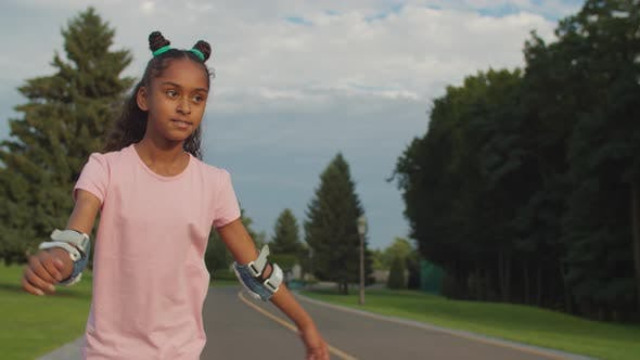 Teenage Girl on Roller Skates Enjoying Ride in Park