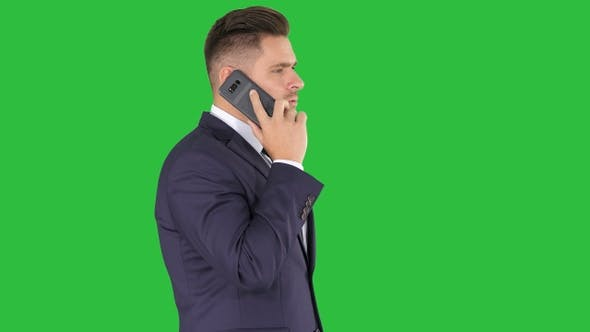 Thumbnail for Businessman talking on the phone on a Green Screen, Chroma Key.