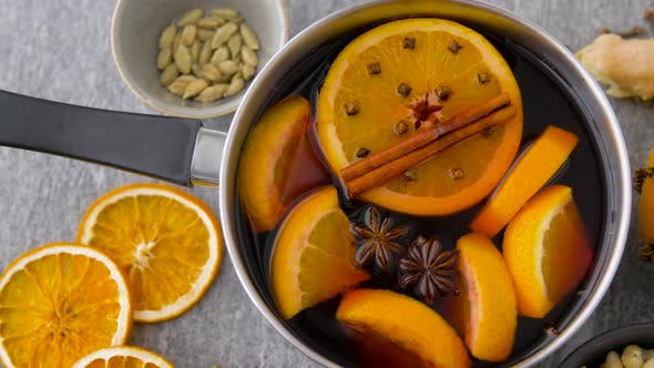 Thumbnail for Pot with Hot Mulled Wine, Orange Slices and Spices