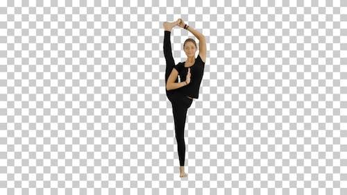 Athletic girl standing in yoga asana utthita, Alpha Channel