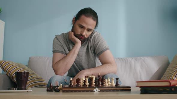Thumbnail for Sad Man Plays Chess Alone