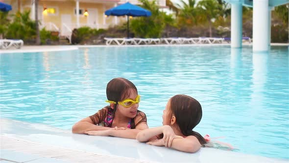 Thumbnail for Adorable Little Girls Playing in Outdoor Swimming Pool Together