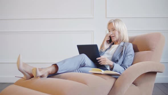 Thumbnail for Middle-aged Businesswoman Having Business Call