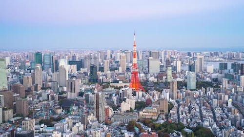 4k Time lapse Day to night of Tokyo tower with buildings in Tokyo City