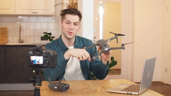 Blogger Records a Video on a Professional Camera, a Man Tries To Record an Interesting Video