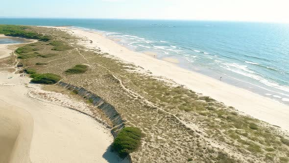 Thumbnail for Aerial View of a Sandy Beach with Waves Coming From the Ocean