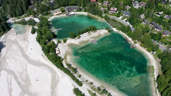 Aerial footage of a beautiful lake with turquoise water, side view of Jasna lake