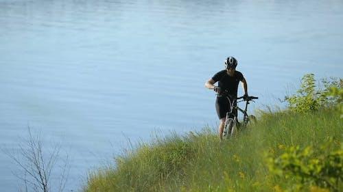 Cyclist Looks Away