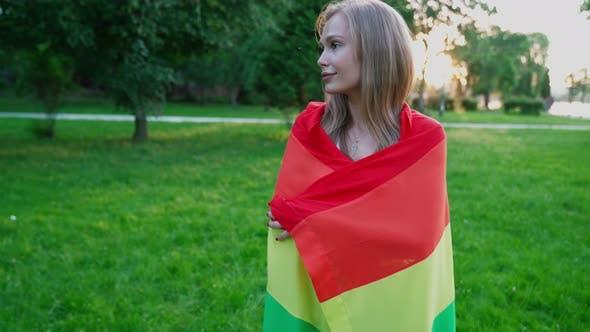 Thumbnail for Tolerant Woman Holding Rainbow Flag Around Body.