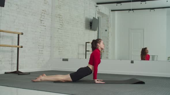 Graceful Sporty Woman Practicing Yoga Poses Indoor