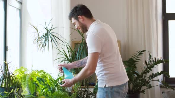 Thumbnail for Man Spraying and Cleaning Houseplants at Home