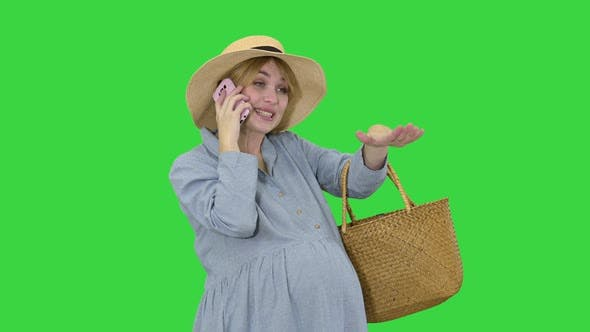 Thumbnail for Pregnant Woman Standing and Talking By Phone in Summer on a Green Screen, Chroma Key