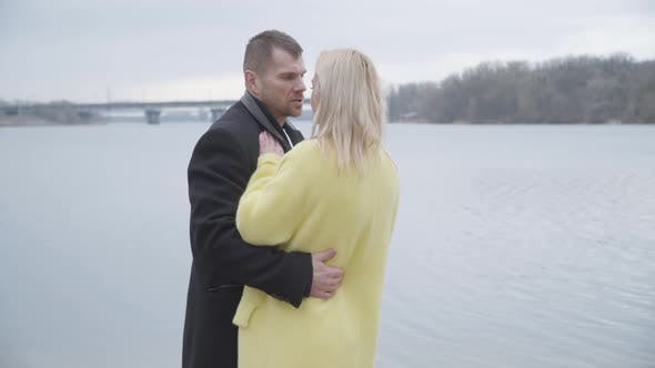 Thumbnail for Confident Caucasian Man Spinning Blond Woman in Sensual Dance on Riverbank