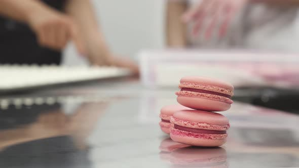 Cover Image for Delicious Pink Raspberry Macaroons on the Table at Commercial Kitchen