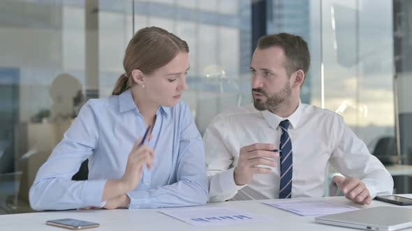 Thumbnail for Business People Discussing the Documents on Office Desk