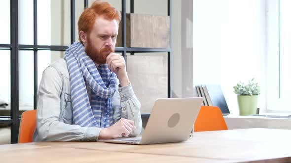 Thumbnail for Pensive Man Working on Laptop in Office