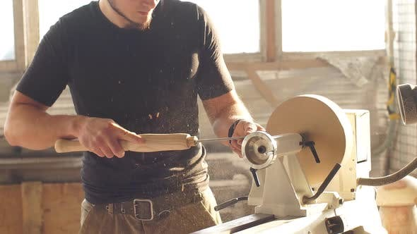 Man Doing Woodwork in Carpentry. Carpenter Work on Wood Plank in Workshop. Concept of Small Business