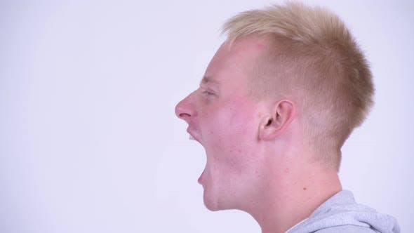 Thumbnail for Profile View of Angry Young Blonde Man Shouting and Screaming