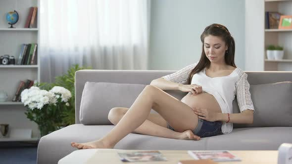 Thumbnail for Mother-To-Be Touching Stomach Gently, Thinking About Child, Positive Thoughts