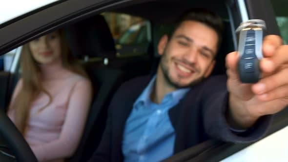 Man Shows Key Through the Car Window