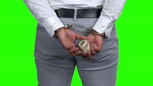 Businessman in Handcuffs Holds Money