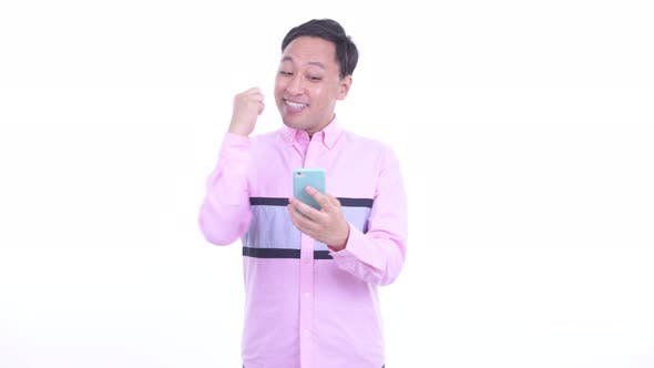 Thumbnail for Happy Japanese Businessman Using Phone and Getting Good News