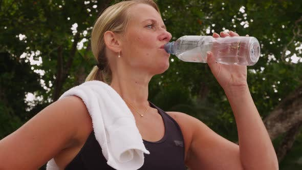 Thumbnail for Woman drinking water after run. Shot on RED EPIC for high quality 4K, UHD, Ultra HD resolution.