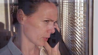 Sad Woman Speak By Window