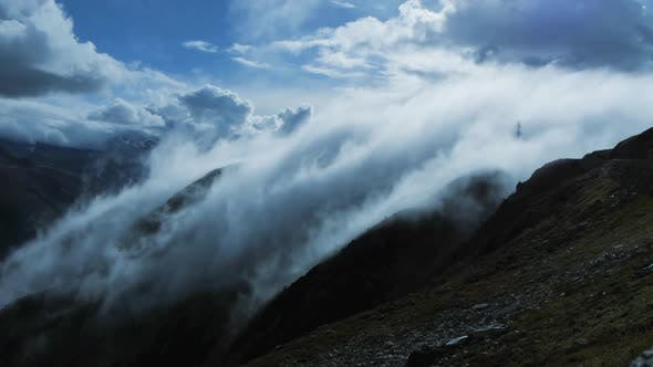 Thumbnail for Fog Clouds Moving Fast Over Mountain Landscape