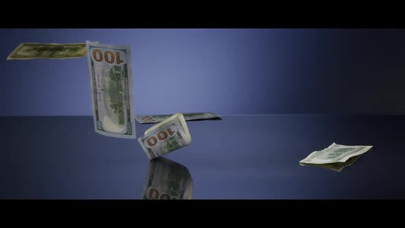 American $100 Bills Falling onto a Reflective Surface - MONEY 0039