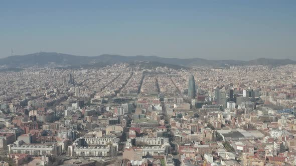 Thumbnail for AERIAL: Barcelona Wide Drone Shot of City Towards Center with La Sagrada Familia and Torre Glories