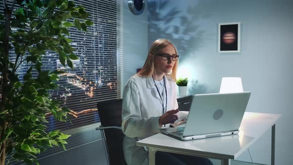 Thumbnail for Psychologist Therapy Session Online: Woman in Lab Coat Making Video Call with Patient on Computer