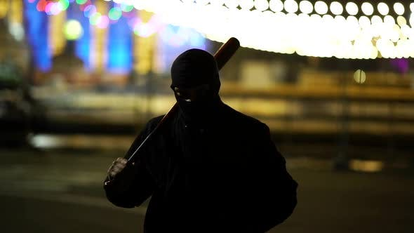 Thumbnail for Man In Balaclava With Bat In Park