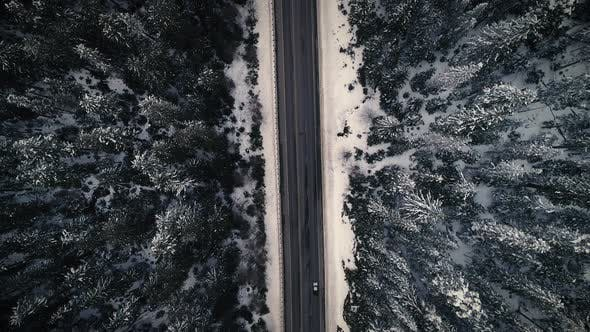 Thumbnail for Drone Above Snowy Mountain Road Trip Surrounded By Snowy Covered Trees