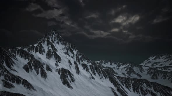 Mountains in Evening Cloudy Sky