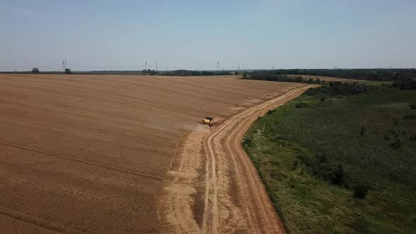 Thumbnail for Aerial View of Combine Harvesters Agricultural Machinery. The Machine for Harvesting Grain Crops.