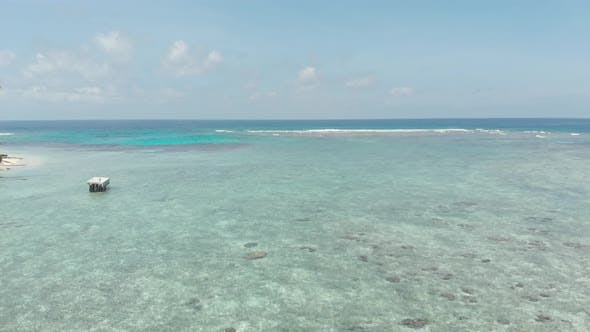 Thumbnail for Aerial: flying over desert islands coral reef tropical caribbean sea, turquoise