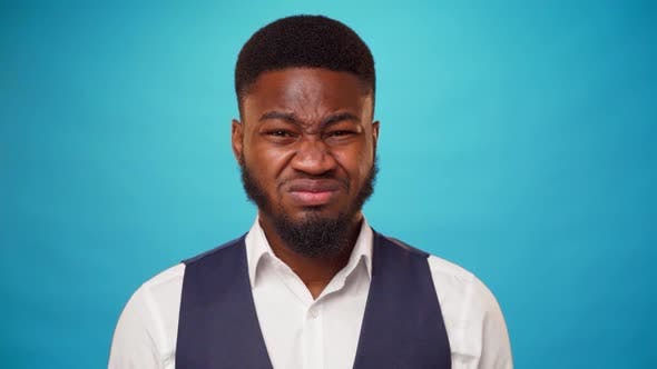 Young Bearded African Man Expressing Disgust and Aversion